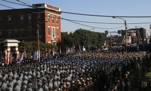Pennsylvania State Police and Troopers from nearby states line streets outside St. Peters' Cathedral in Scranton, during funeral procession carrying slain Pennsylvania State Police Trooper Corporal Dickson to the Cathedral for his funeral service
